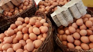 multiples baskets filled with large brown eggs